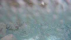 Man and boy in a hot tub with bubbles Stock Footage