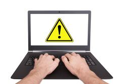 man working on laptop, danger - stock photo