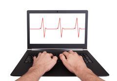 Man working on laptop, heartbeat Stock Photos