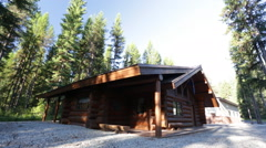 Log house in forest tracking Stock Footage