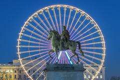 Stock Photo of place bellecour, famous statue of king louis xiv and the wheel