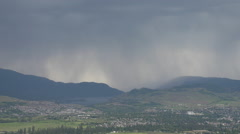 Weather, rain showers over lake Stock Footage