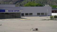 Abandoned big car lot empty open sign, strange juxtaposition Stock Footage
