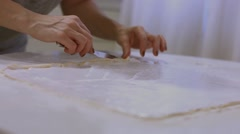 She smears white sweet cream on the dough Stock Footage