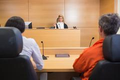 Lawyer and client listening to judge Kuvituskuvat