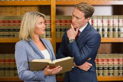 Team of lawyers in the law library - stock photo