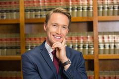 Stock Photo of Handsome lawyer in the law library