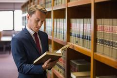Handsome lawyer in the law library - stock photo