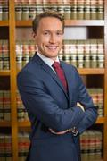 Lawyer smiling in the law library Stock Photos