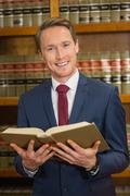 Stock Photo of Lawyer reading in the law library
