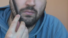 White young man comb his black thick beard, close up to face, style, self care Stock Footage