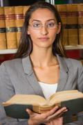 Lawyer reading book in the law library Stock Photos