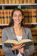 Stock Photo of Lawyer reading book in the law library
