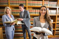 Lawyers in the law library - stock photo