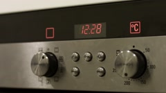 Electronic clock work on the oven in the kitchen Stock Footage