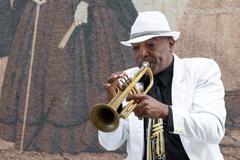 Black cuban musician playing the trumpet Stock Photos