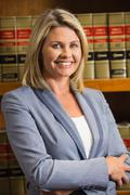 Stock Photo of Lawyer smiling at camera in law library