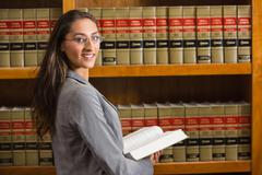 Lawyer looking at camera in the law library Stock Photos