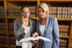 Lawyers talking in the law library Stock Photos