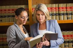 Stock Photo of Lawyers talking in the law library