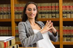 Stock Photo of Pretty lawyer in the law library