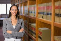 Pretty lawyer in the law library - stock photo
