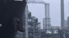 Petrochemical refinery + close up moving bow + nameplate Pieter Schelte ship Stock Footage