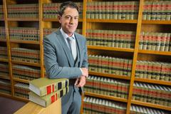 Lawyer standing in the law library - stock photo