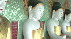 Sagaing, inside the U Min Thonze Cave, Buddha statues in a row Stock Footage