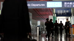 passengers farewell in front of departure gate in airport terminal - stock footage
