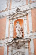 sculpture of a woman on the front of the house - stock photo