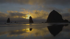 View of Haystack rock at sunset on Cannon Beach - stock footage