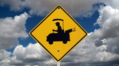 Golf Cart Crossing Safety Sign with cloud Time Lapse Stock Footage