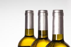 detail of three wine bottle on white  background. - stock photo