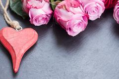 red and pink  roses  on table - stock photo