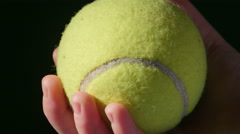 2732 Holding and Dropping Tennis Ball, 4K - stock footage