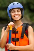 Stock Photo of Portrait Of Smiling Young Lady Wearing White Water Rafting Equipment