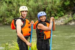 Adult Couple Prepared For White Water Rafting Trip Specific Equipment Stock Photos