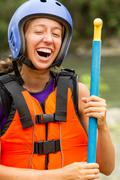 Stock Photo of Portrait Of Young Lady Laughing White Water Rafting Equipment