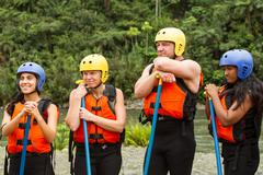 Stock Photo of Group Of Four Mixed People Prepared For White Water Rafting