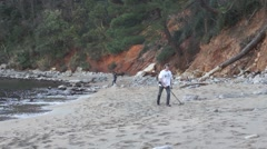 Man with metal detector on the beach Stock Footage