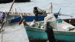 Stock Video Footage Thai Fisherman Carries A Heavy Bag With Seafood Sea Thailand Stock Footage