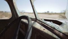 Shattered inside of a cabine of an abandoned car in Namibia, dolly shot - stock footage