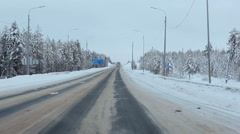 View from car moving on the Kola highway in north of Karelia with road sign Stock Footage