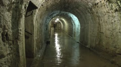 Wide, wet corridor in Fort Douaumont, near Verdun, France. Stock Footage