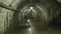 Typical damp tunnel within Fort Douaumont, near Verdun, France. Stock Footage