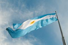 Flag buenos aires growing against the blue sky. Stock Photos