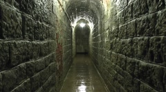 Damp, dripping corridor (with audio) inside Fort Douaumont, near Verdun, France. Stock Footage