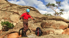 Cliffhanger packs the rope Stock Footage