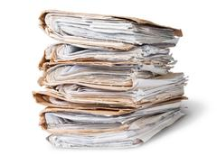 Old files arranged in chaotic stack rotated Stock Photos
